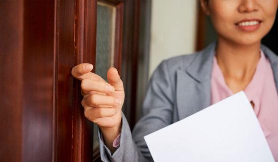 Agent knocking on door